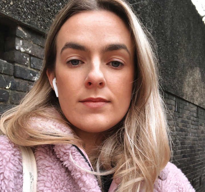 image of Niamh Donoghue | Founder of Soundboardwhite young oman, wearing a pink coat